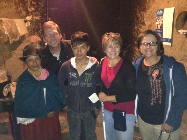 Theresa, Phil and Jennifer with Bolivia and 14-year-old Jimmy in the kitchen of their adobe home. Jimmy is one of the children sponsored through Compassion.